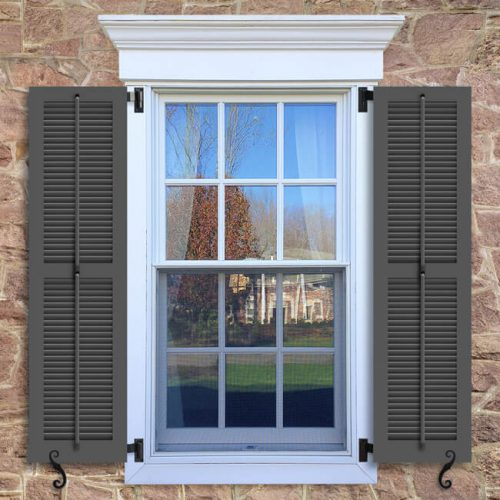 Window with brown shutters in a 1002 configuration, 2 panels, LBO, operable louvers with 50/50 layout.