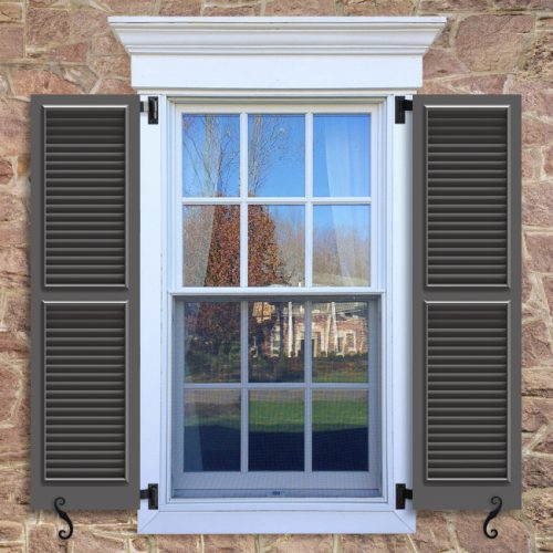 Window with brown shutters in a 1002 configuration, 2 panels, TR1, fixed louvers with 50/50 layout.