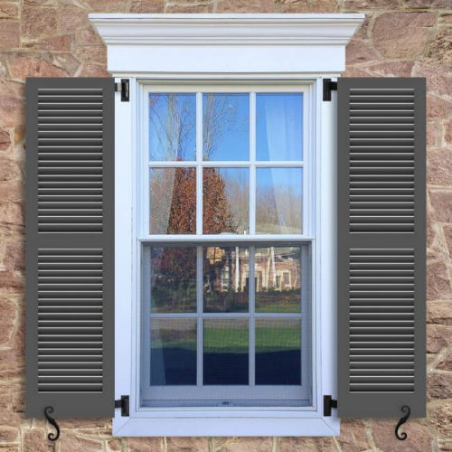Window with brown shutters in a 1002 configuration, 2 panels, TR2, fixed louvers with 50/50 layout.