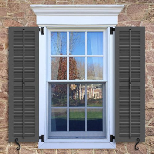 Window with brown shutters in a 1002 configuration, 2 panels, WLO, operable louvers with 50/50 layout.