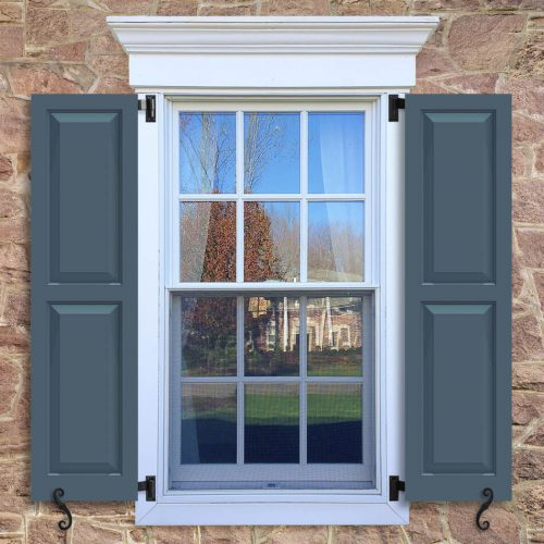 Window with blue shutters in a 1002 configuration, 2 panels, CT3, colonial trim panels with 50/50 layout.