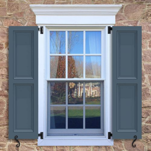 Window with blue shutters in a 1002 configuration, 2 panels, UB1, raised panels with 50/50 layout.