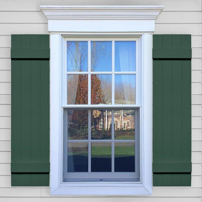 Window with green joined vinyl board and batten shutters in VIN BBJ layout.