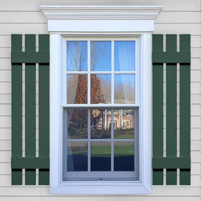 Window with green spaced vinyl board and batten shutters in VIN BBO layout.