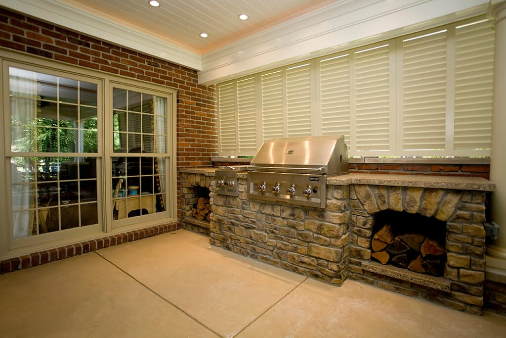 These White Bermuda Shutters Create A Moveable Shade And Privacy Wall That  Completes This Outdoor Grilling