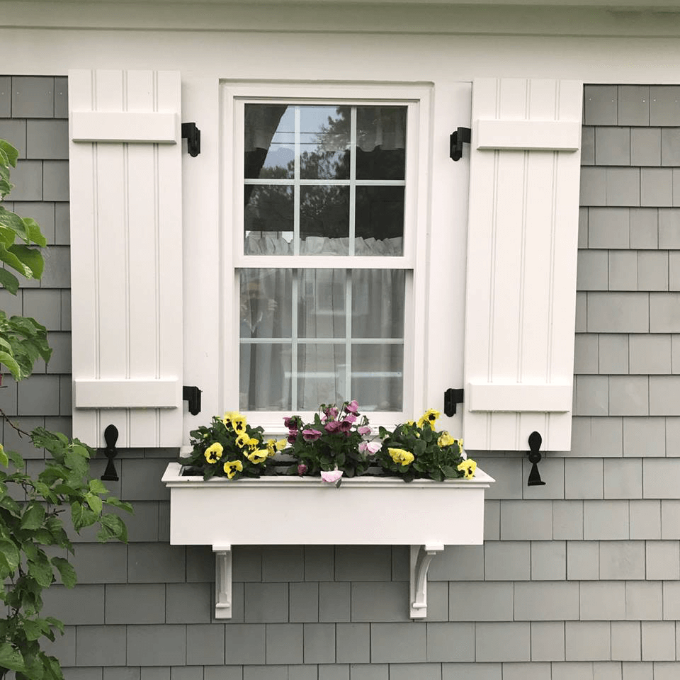 White Shutters On Gray House With Flower Box