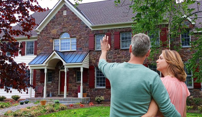 Home owners imagining house with custom exterior shutters after receiving expert advice from Timberlane