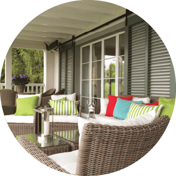 Green louver shutters on porch illustrating the personalized experience customers receive when doing business with Timberlane