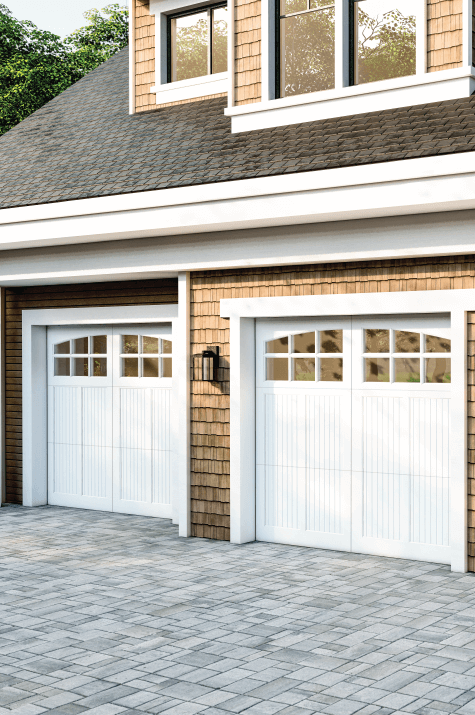 white carriage collection garage door on wood shakes house